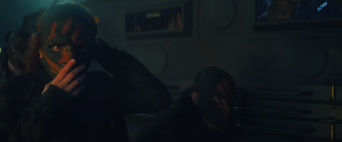 Flag Smashers troops in their black masks with red handprints, in Falcon and the Winter Soldier