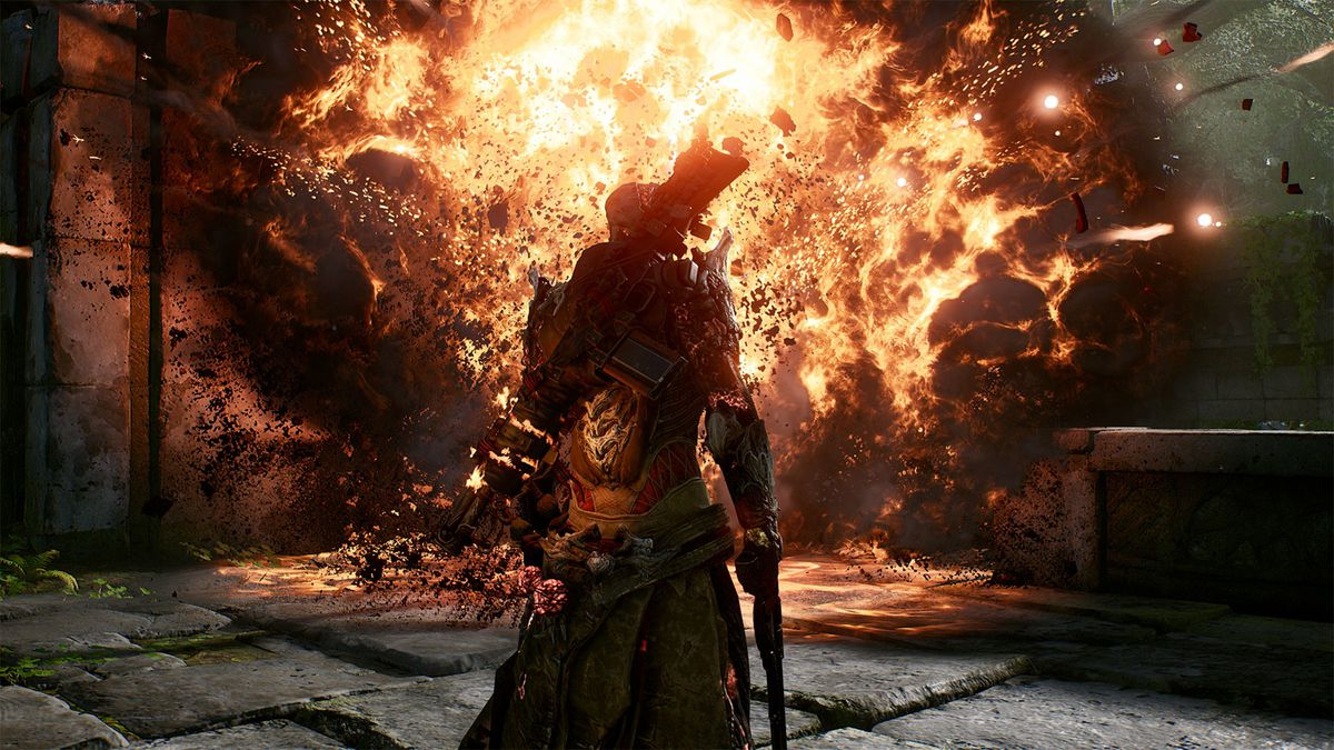 A character in Outriders stands in front of explosion