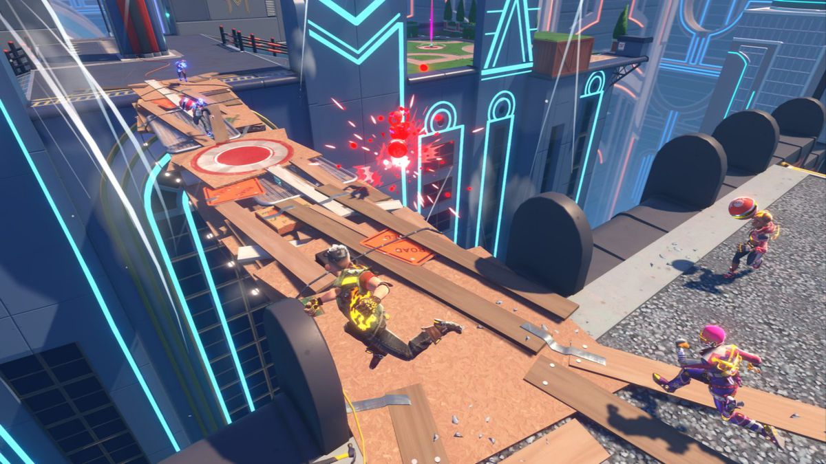 Players run across a makeshift, destructible bridge spanning two rooftops in Knockout City