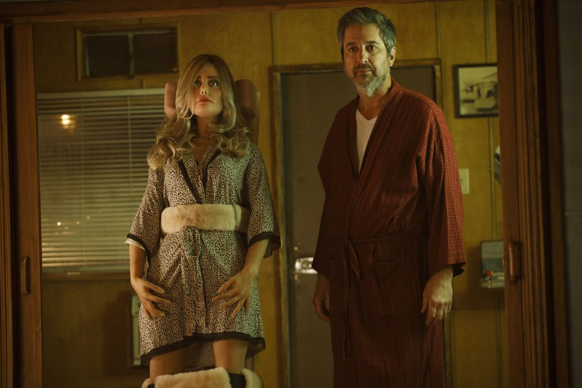 Ray Romano as Herbert Greene stands next to his sex doll, Diane.