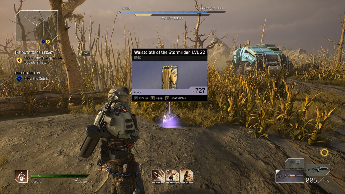 The player character in Outriders inspects a piece of loot before picking it up
