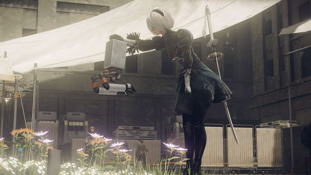 A screenshot of Nier: Automata in which 2B pets her robot pod