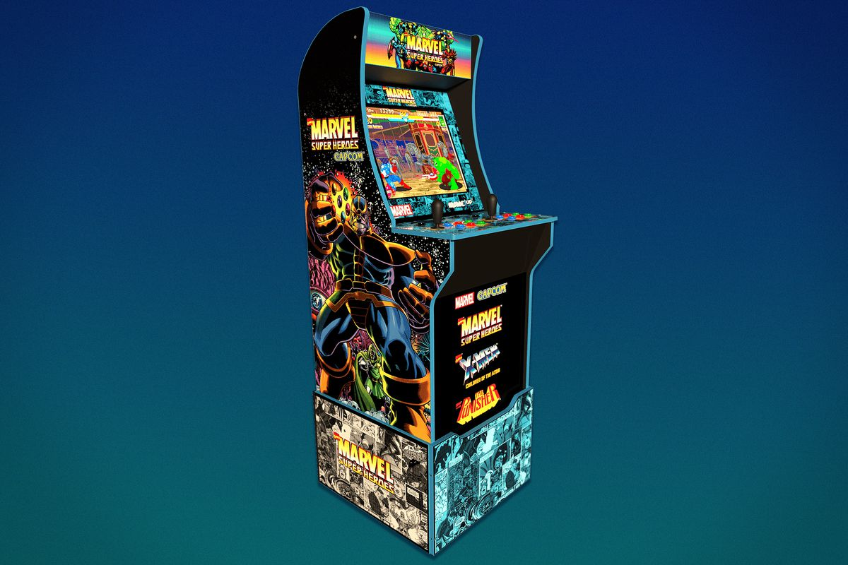 A 3/4-size arcade cabinet with a Marvel Super Heroes logo sits on a riser