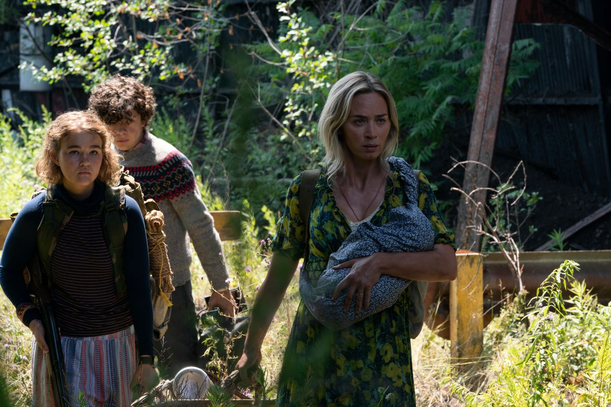 Regan, Marcus, and Evelyn walking through the woods in A Quiet Place Part II