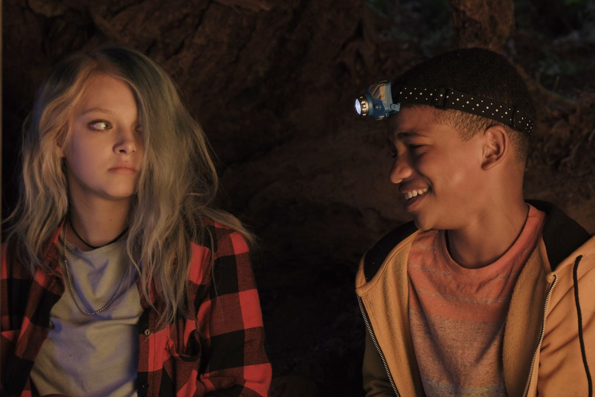 Lonnie Chavis grins at Amiah Miller, who looks doubtful, in The Water Man.