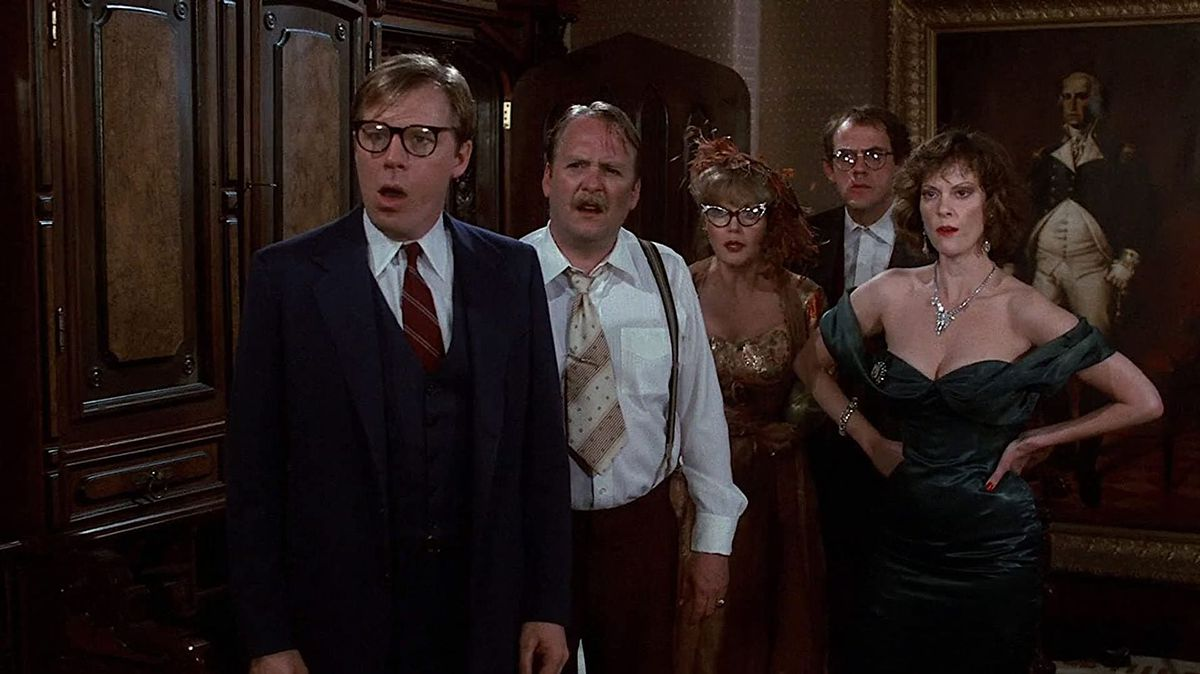 Five cast members in Clue gawp at the camera in response to the latest murder