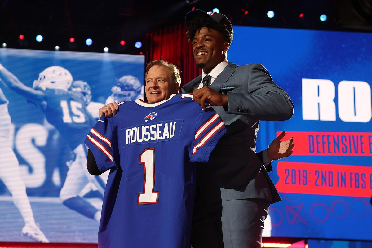 2021 NFL Draft: Gregory Rousseau stands with NFL Commissioner Roger Goodell onstage
