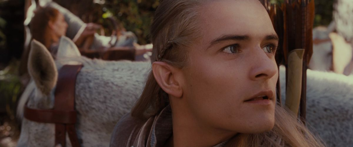 Legolas looks around Rivendell as he arrives in The Fellowship of the Ring.