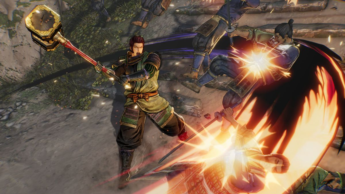 A character in Samurai Warriors 5 sweeps back his enemies with a staff