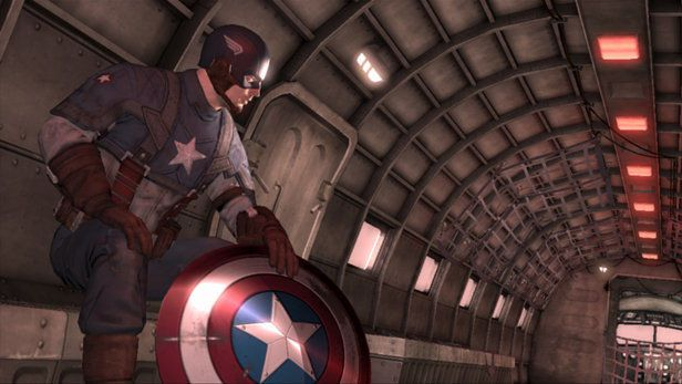 Captain America sits on a plane, with his shield on the ground in front of him
