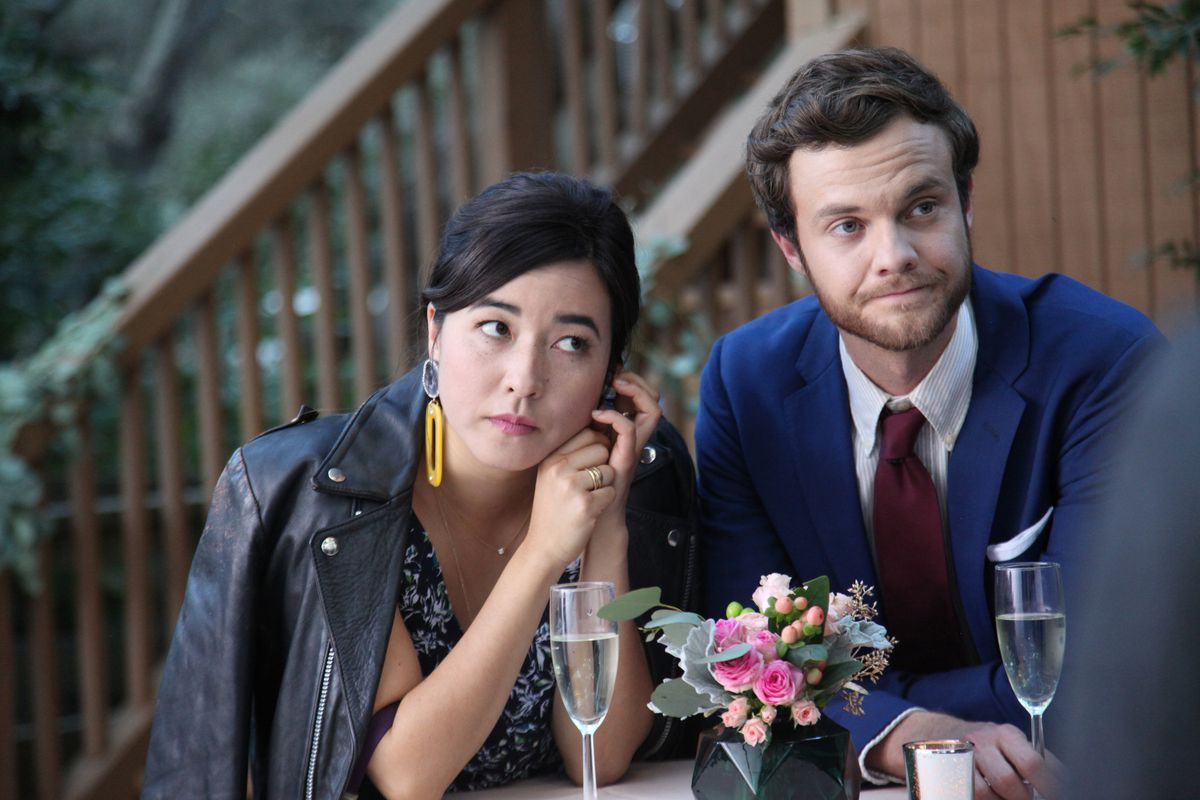 Maya Erskine (Pen15) and Jack Quaid (The Boys) looking nice for a wedding in Plus One