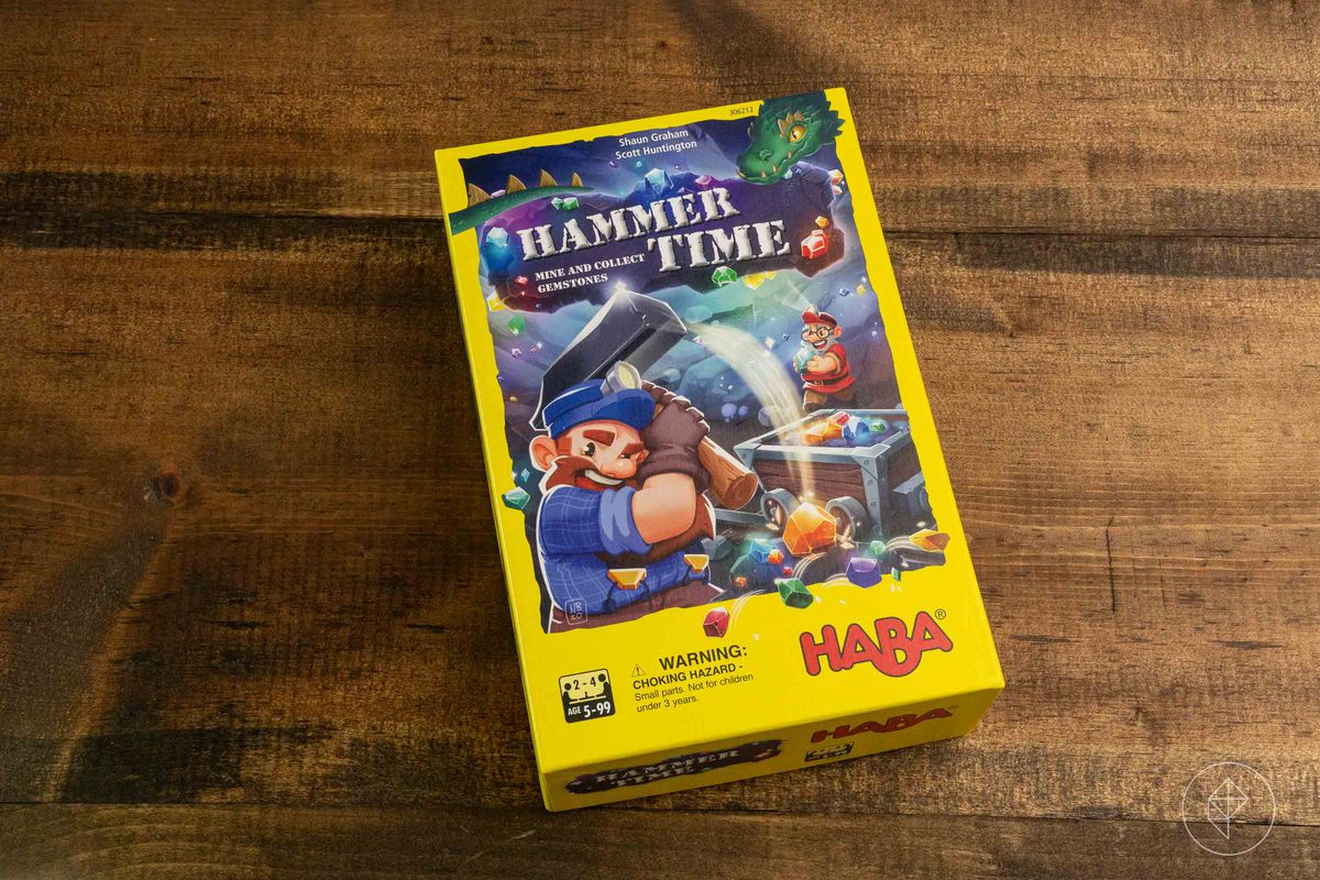 Box art for Hammer Time showing a dwarf swinging a hammer inside a mine. In the corner a green dragon looks on.
