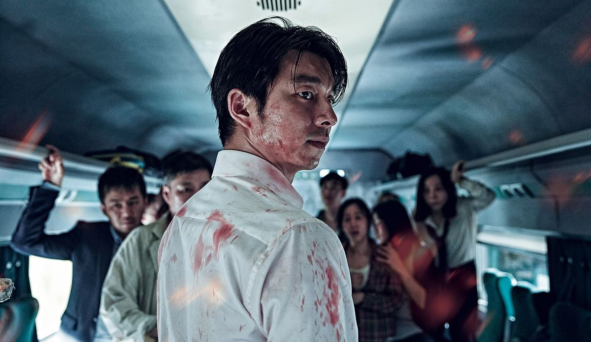 A bloodied Seok-woo (Yoo) looks over his shoulder.