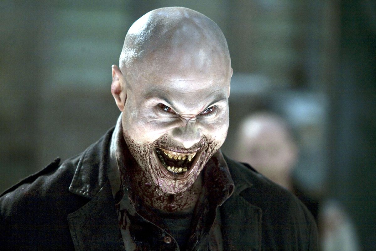 A blood drenched vampire leers with fanged teeth in 30 Days of Night