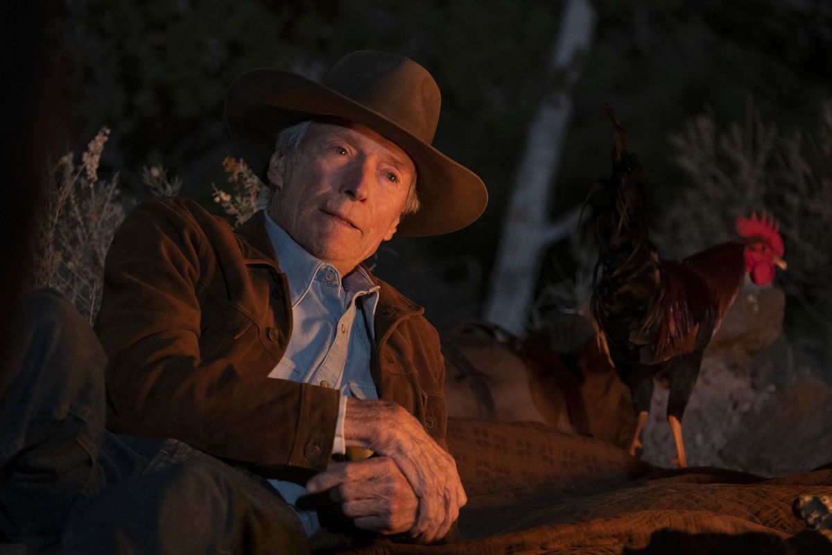 Mike Milo (Clint Eastwood) sitting beside a campfire in Cry Macho.