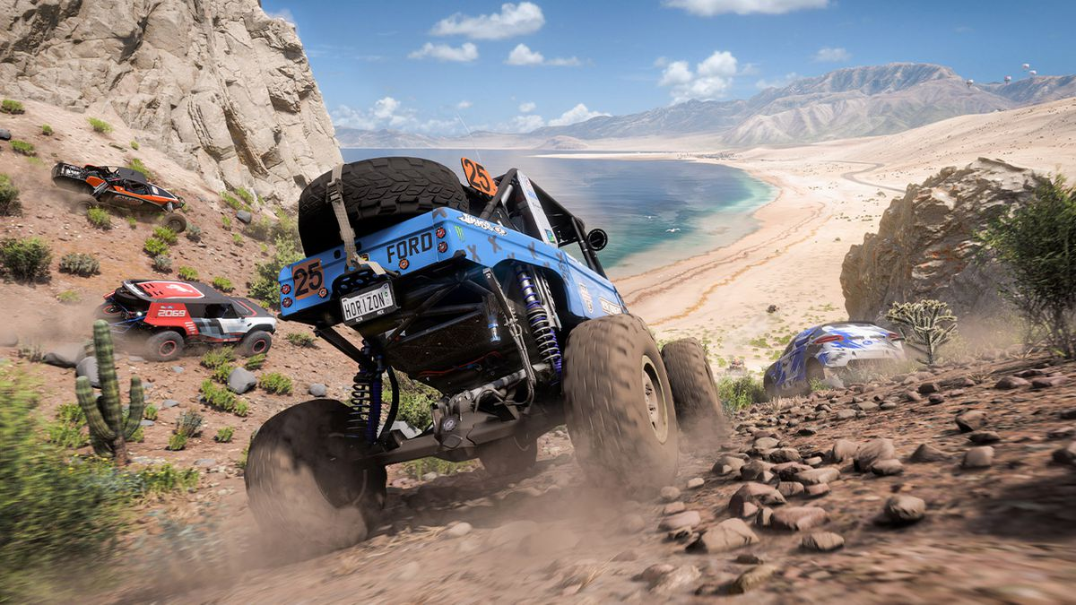 A Ford truck with large wheels rolls through hills above a beach in Forza Horizon 5