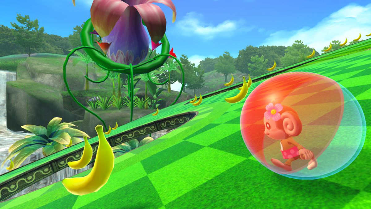 A character rolls around in a ball, collecting bananas