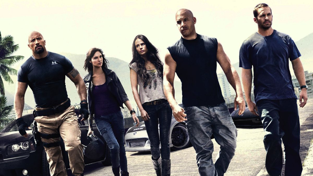 Fast Five's cast walking together in a promo still, including Vin Diesel, Dwayne Johnson, and Gal Gadot