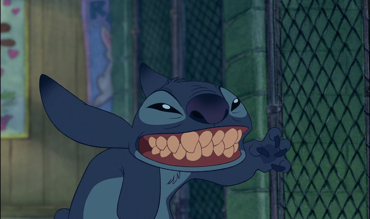 stitch with a toothy grin waving