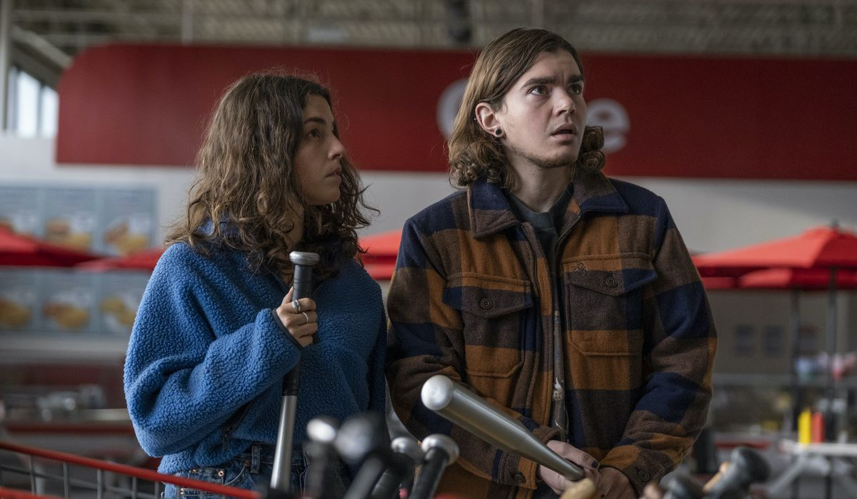 Elliot Fletcher as Sam and Olivia Thirlby as Hero cling to baseball bats while preparing for a possible attack inside a big-box store in Y: The Last Man