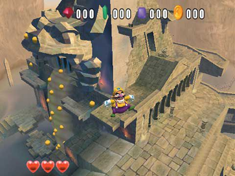 Wario is standing on the ledge of a stone walkway, and gold coins are pouring out beside him